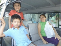 Maria and two of her eight children